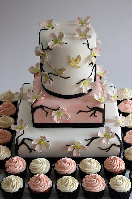 """Dogwood Blossom Wedding Cake with Cupcakes by Becky Colletti, ConsumedByCake on Flickr. A 12"""", 8"""" and 6"""" triple height wedding cake decorated with fondant Dogwood blooms, royal icing branches and hand cut fondant birds painted with gold lustre.  #wedding #cake #dogwood #floral #blossoms"""