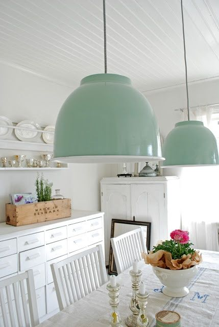 white coastal dining room. White shelves and rustic chairs, And overhanging pendant lights to top it off x