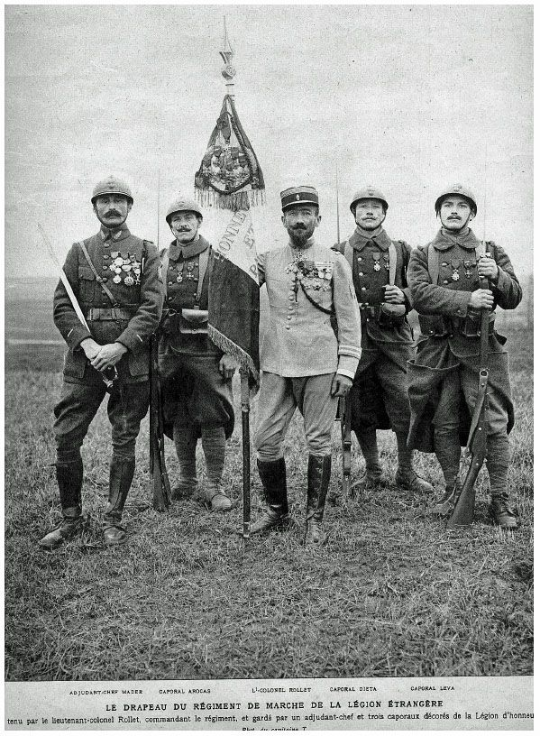 Le Drapeau du Regiment de Marche de La Légion Étrangère. Lieutenant-Colonel Rollet is Holding the Légion's Flag.