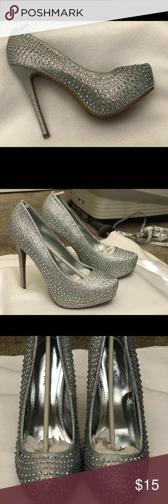 Silver Rhinestone High Heel Stilettos Brand new silver rhinestone heels. Fabric material with shimmery rhinestones. Heel approximately 5 inches high. Very pretty with a Cinderella type vibe. Purchased for party but they were too high and fit more like a size 7.  So Im selling these as a size 7 but the shoe state that they are a size 8. I am a true size 8 and this ain't no 8; a girl's toes don't lie! le miu Shoes Heels
