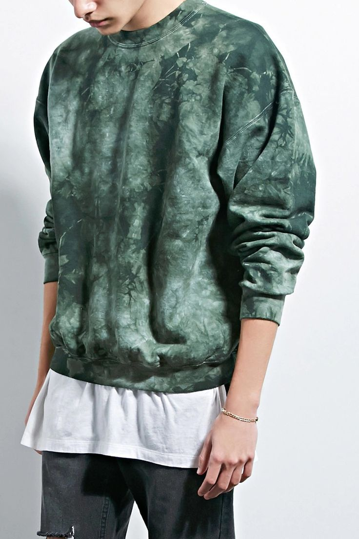 A fleece sweatshirt by EPTM.™ featuring a tie-dye design, round neckline, long dropped sleeves, and a ribbed trim.