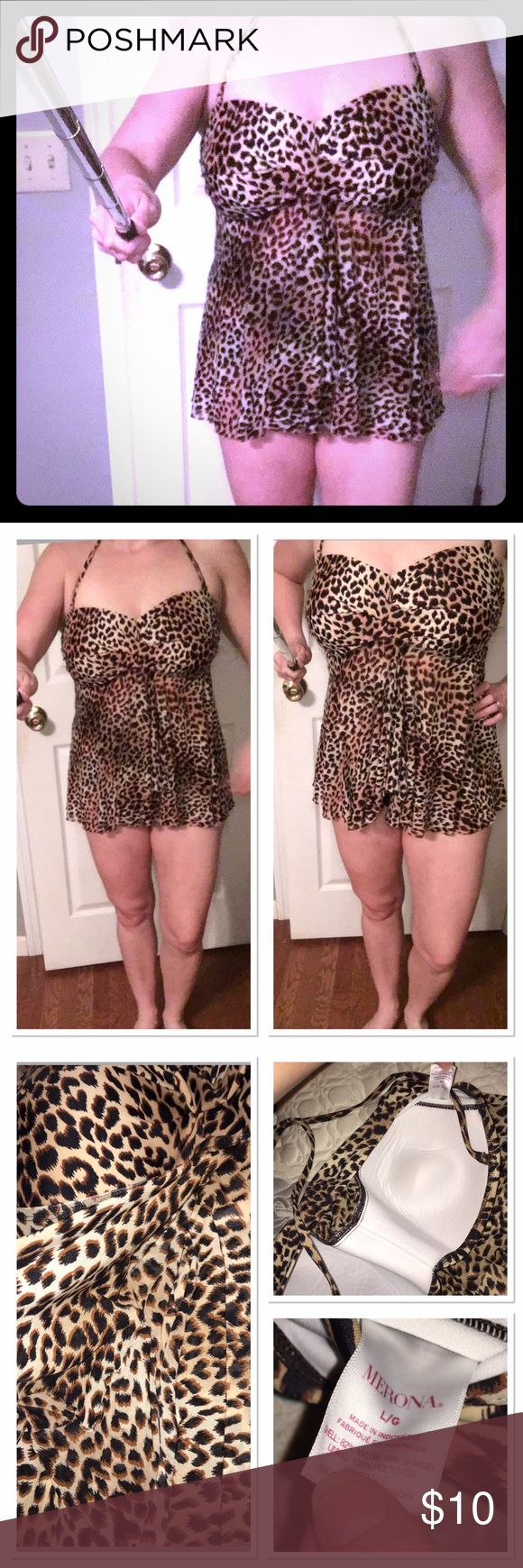 Leopard Tankini Top Super cute leopard tankini top. The cups has padding and the bottom is a Chiffon type material overlay. I just wore plain black bottoms with this and I also used as a maternity Swimsuit since the bottom portion opens. It's a little big on me now which is why I'm selling it, perfect for anyone who still wants to look trendy and cute but cover up too! Merona Swim