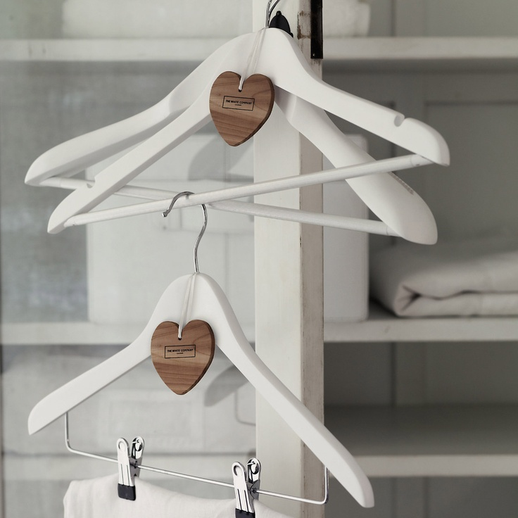White, wooden coat hangers with a cedar heart attached.  Love these!