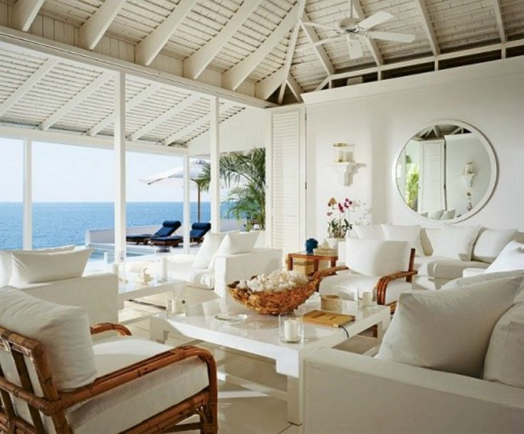 Architectural digest beach cottages white slipcover sofas chairs and rattan lounge chairs beach homeshome decorbeach