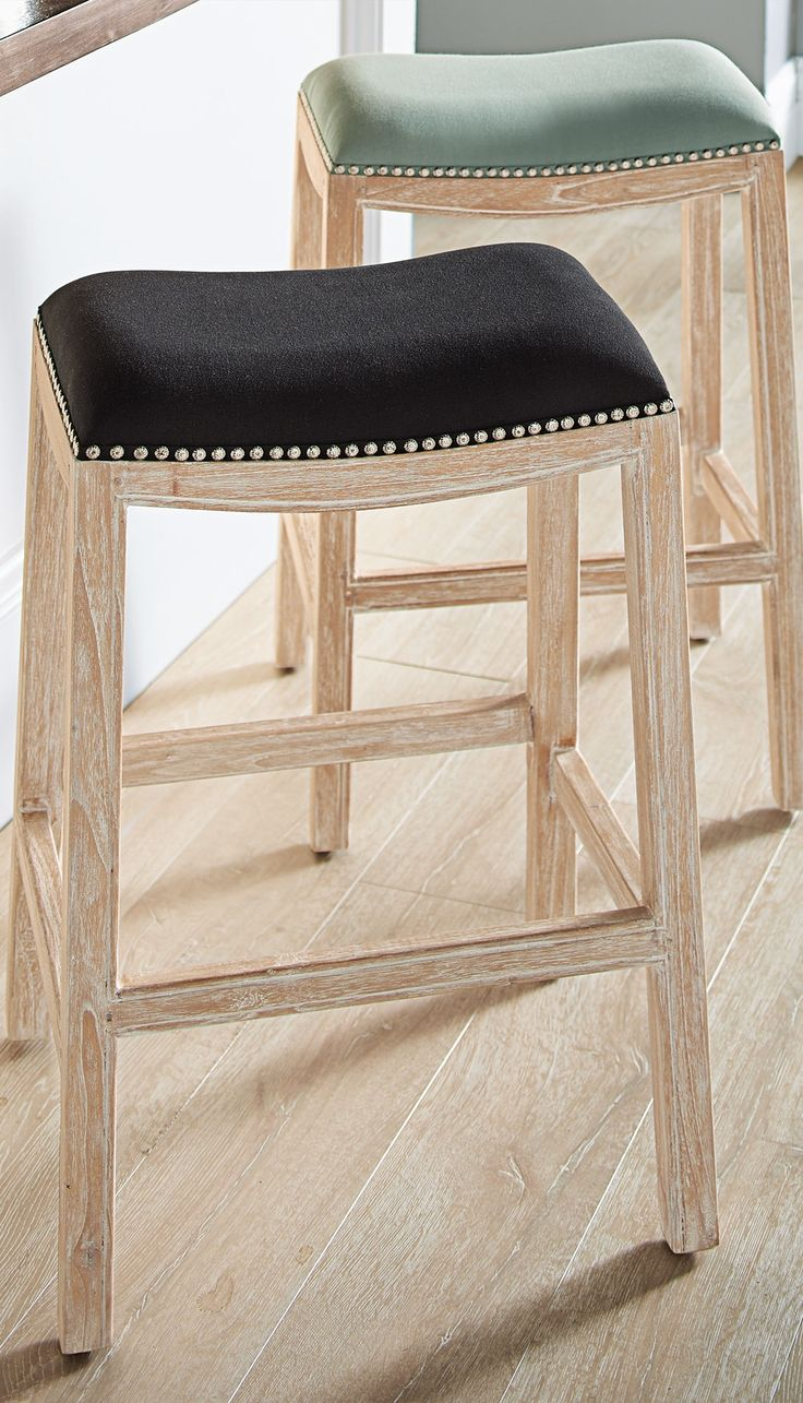 With A Lighter White Washed Finish And A Fabric Seat The