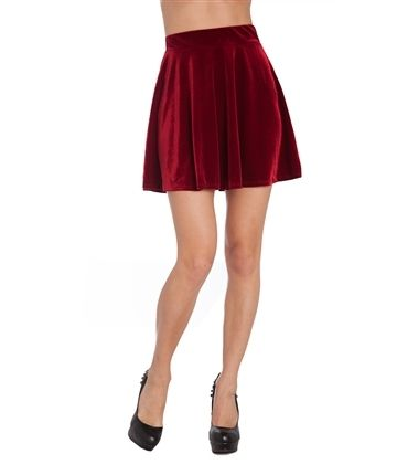 """Velvet is perfect for the coming seasons! Look fabulous in this burgundy velvet skirt. Pair it with a cream or Ivory top.  Skirt Length: 17"""" Material: 95% Polyester, 5% Spandex Color: Burgundy Sizes Available: Small, Medium, Large Care: Hand wash cold"""