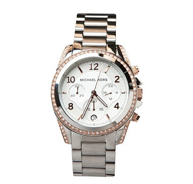 Glamorous accents feminize this menswear-inspired watch by Michael Kors™.