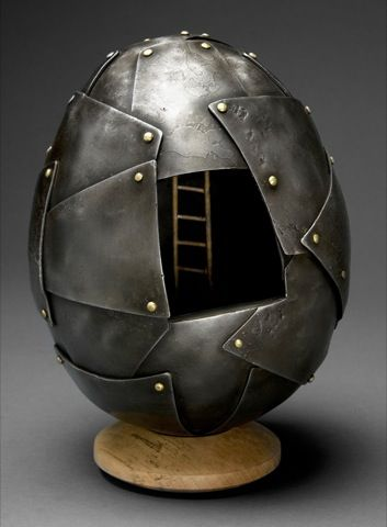 Patrick Maher blacksmithing~egg Because of my love of metal working, I think this piece is awesome. Not only does the metal look like it was worked very well, I think the brass rivets or screws are a great addition. The ladder inside, is puzzling, yet I think it is really cool. The contrast in colors from the dark grey/black and then the gold or brass colored rivets.