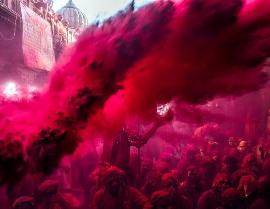 What a fun celebration! Hindu devotees throw colored spice during the traditional Lathmaar Holi celebrations, March 21, 2013, in the village of Barsana, near Mathura, India.