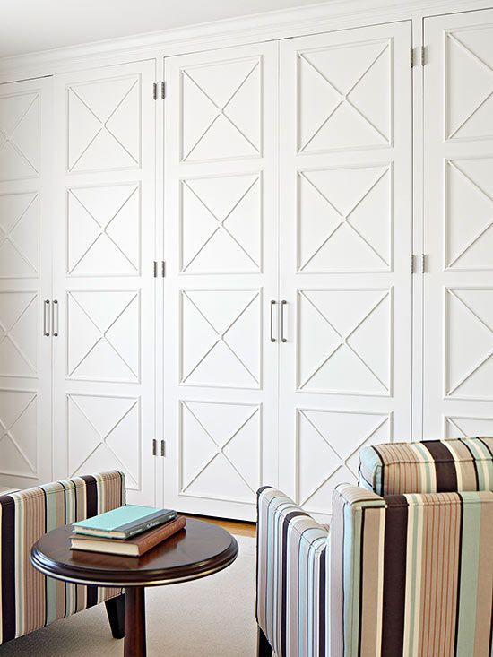 Plain floor to ceiling cabinets dressed up with slender molding in a repeating pattern. Love!