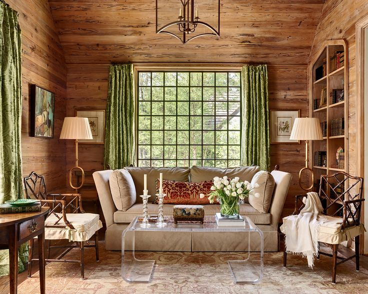 Rustic chic living room with pecky cypress walls, beautiful green Cowtan & Tout fabric - Gray Walker