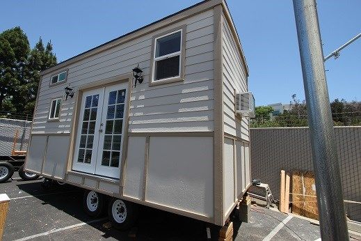 9 x 22 Modern Caravan Tiny House professionally built w/ composting toilet full kitchen and appliances on the Tiny House Marketplace.