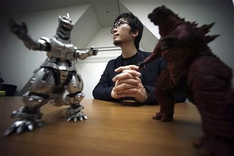 In this May 20, 2015 photo, Shunsuke Fujita, Godzilla video game's producer of Bandai Namco Entertainment, speaks on new Godzilla game for the Sony Corp. PlayStation 4 home machine in Tokyo. (AP Photo/ Eugene Hoshiko) ▼1Jun2015AP|New Godzilla video game steers clear of nuclear references http://bigstory.ap.org/article/1094bfd0b9e5440da828f5e0b3e6f8cf/new-godzilla-game-steers-clear-nuclear-references