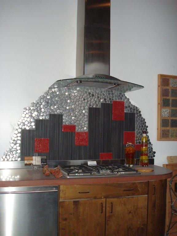 Eclectic stainless steel peebles, glass and tile backsplash