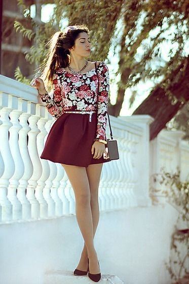 Go for a black floral longsleeve shirt and a burgundy skater skirt for a standout ensemble. Polish off the ensemble with burgundy suede pumps.  Shop this look for $58:  http://lookastic.com/women/looks/black-longsleeve-shirt-and-burgundy-skater-skirt-and-black-clutch-and-burgundy-pumps/2577  — Black Floral Long Sleeve T-shirt  — Burgundy Skater Skirt  — Black Clutch  — Burgundy Suede Pumps