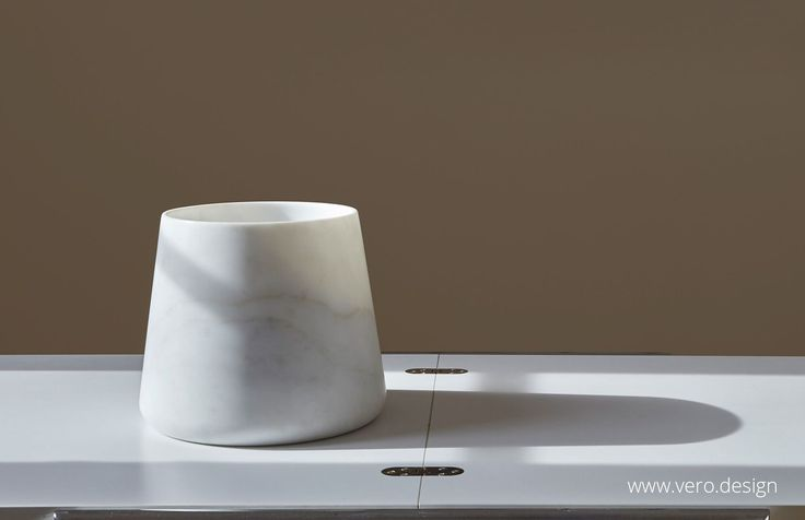 Carrara is where Michelangelo came to source the marble for his masterpieces and to this day supplies marble of the finest quality to a discerning market. These minimalist designs are intended to express a new classicism whilst fitting seamlessly into contemporary life. Hand crafted by a master craftsman in Carrara, the Designer has sought to bring a sense of serenity and timelessness to the enduring beauty of marble.