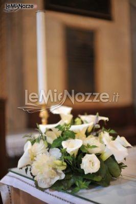 http://www.lemienozze.it/operatori-matrimonio/fiori_e_addobbi/fiorista-mantova/media/foto/17  Centrotavola di calle, rose e peonie bianche