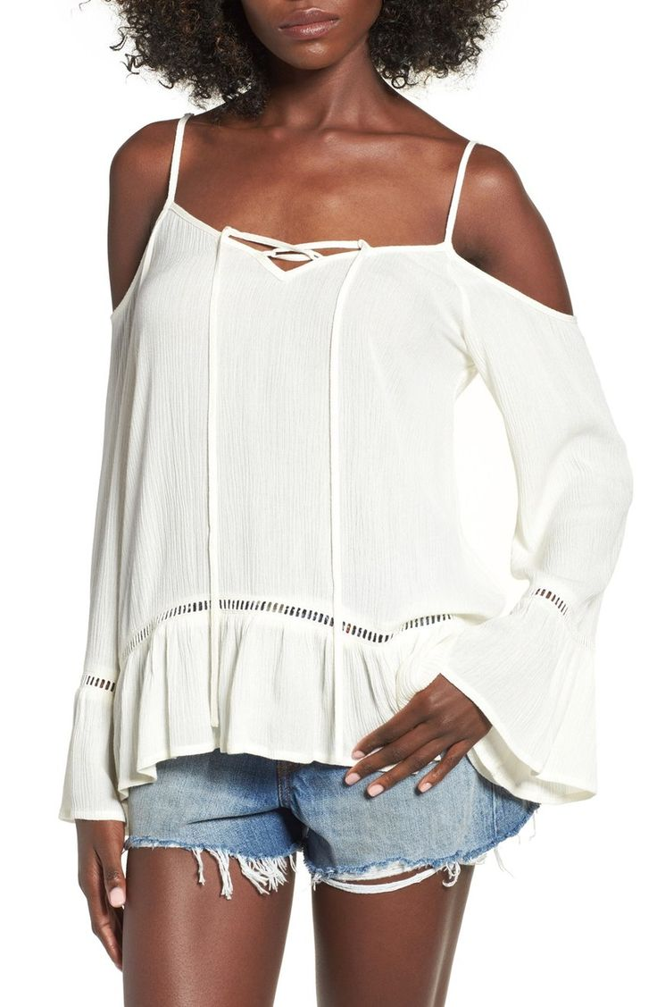Drapey and laid-back, this strappy cold shoulder top is lightened with airy ladder lace at the bell-sleeve cuffs and ruffled hem.