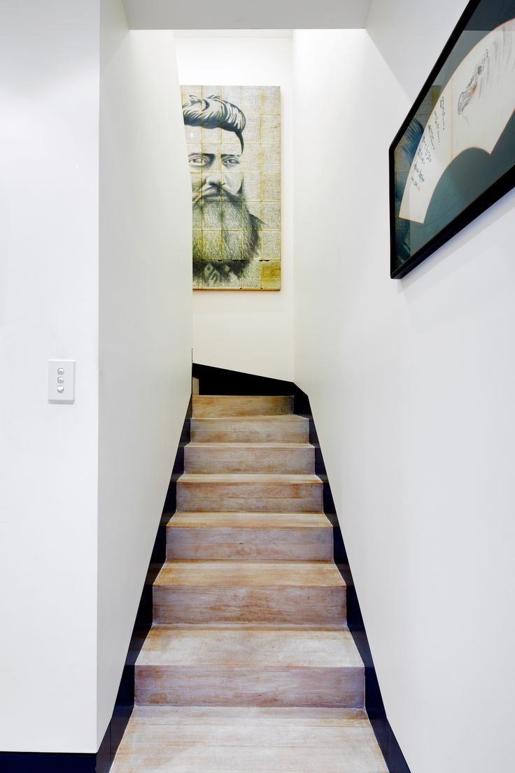 Stairwell to the master bedroom with limewax, kaolin clay and soap flake finish. artwork by Luis Trujillo. Brooke Aitken Design.