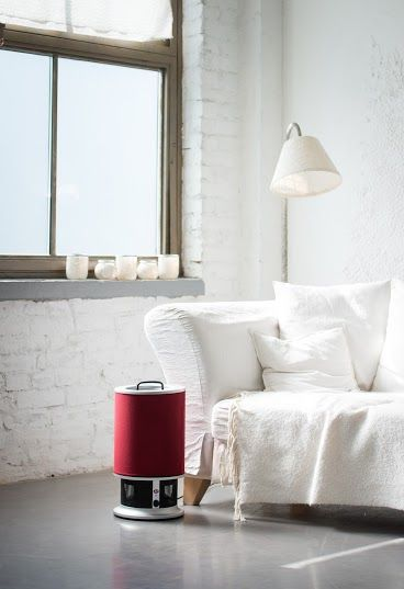 Raw, white walls minimalist-industrial loft with stylish interior and Lux Aeroguard Mini Air Purifier.