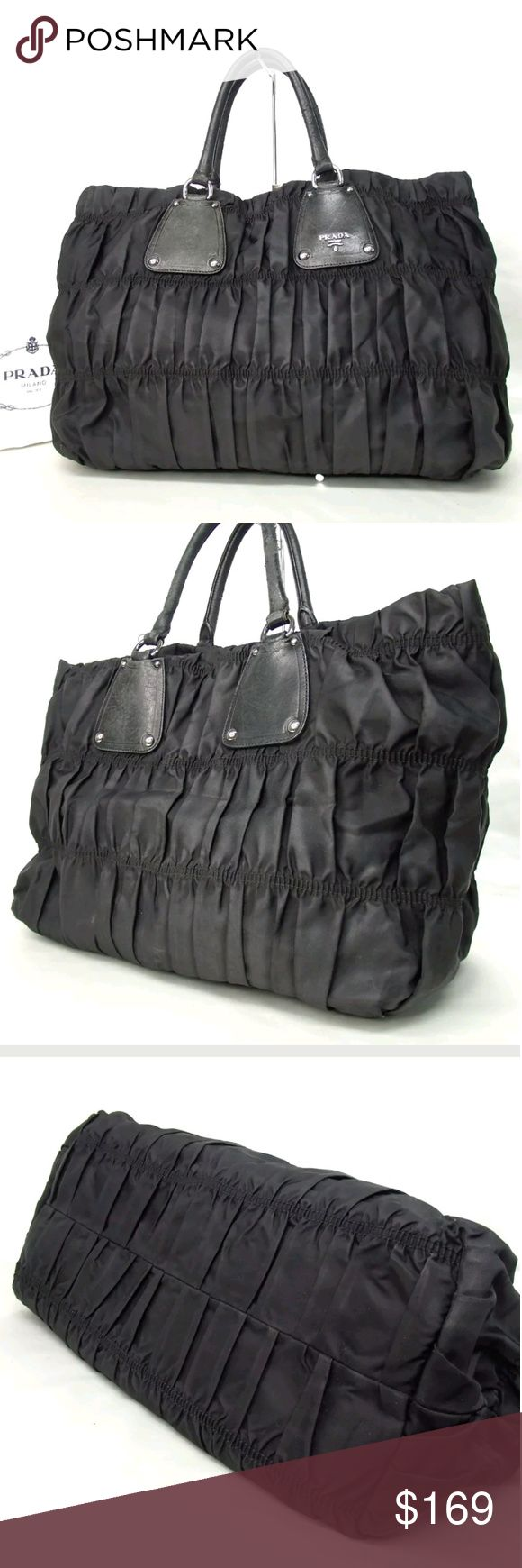 Prada Tessuto gaufre nylon tote This authentic Prada Tessuto Gaufre Tote is beautifully and intricately crafted in classic black and adorned with silver-tone hardware accents. Constructed in tessuto nylon, this bag features dual-rolled handles and trademark Prada logo. Ultra-spacious interior is lined with Prada's monogram fabric housing daily essentials. Super contemporary chic bag. In good used condition. Dust bag included. 8597 W45-38cm x H29cm x D16cm Handle:42cm W17.7' x H11.4' x D6.3'…
