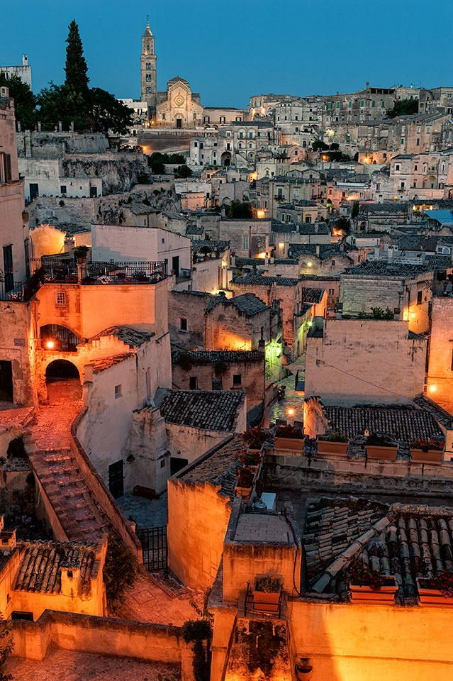 """The Sassi di Matera (meaning """"stones of Matera"""") are ancient cave dwellings in the Italian city of Matera, Basilicata. Situated in the old town, they are composed of the Sasso Caveoso and the later Sasso Barisano. (Wikipedia)"""