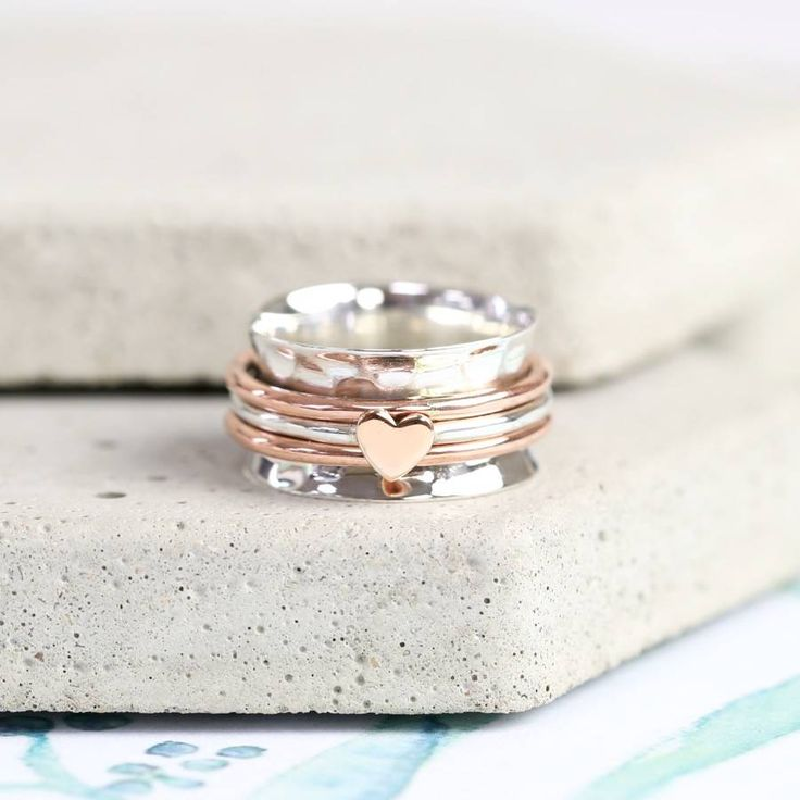 Are you interested in our spinning rings? With our Sterling Silver and Rose Gold Heart Ring you need look no further.