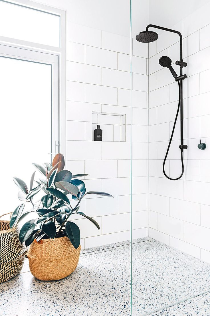 white modern shower with black fixtures