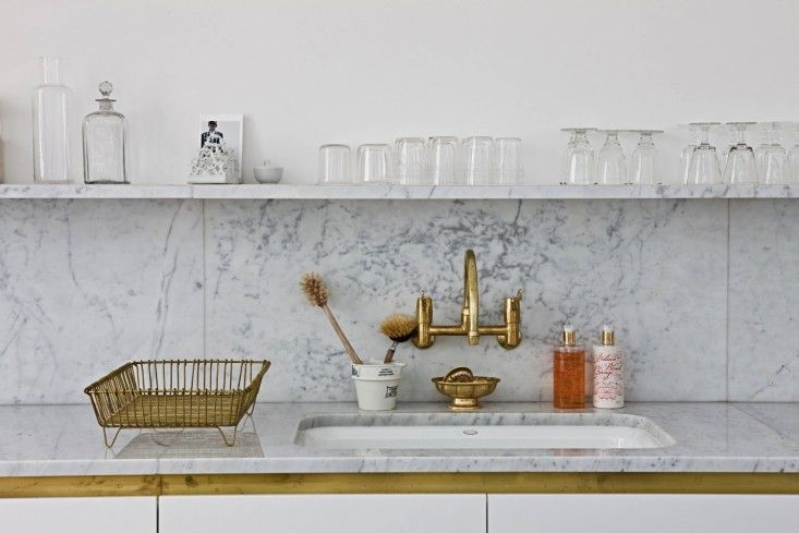 Harriet Anstruther Kitchen Steal This Look/Remodelista  http://www.remodelista.com/posts/steal-this-look-harriet-anstruther-brass-and-marble-kitchen-in-london