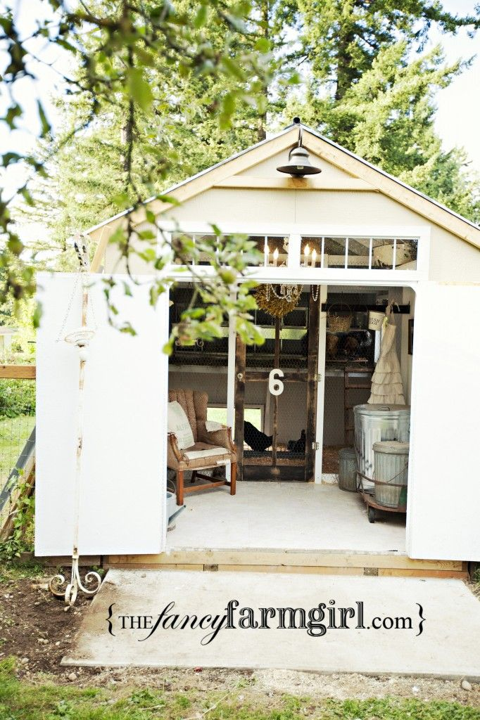 swanky chicken coop, love the galvanized feed bins, the chair for spending quality time with the chickens too.  Also love the barn light on the outside!  Windows up high give lots of light too!  Neat screen door entry into the chicken's section of the coop/shed.