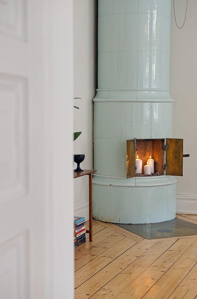 soft blue scandinavian fireplace