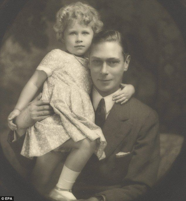 Child Queen: Elizabeth with her father who went on to become King George VI in a photo taken in July 1929