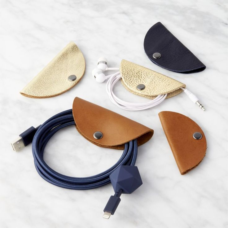 $29 Shop set of 5 cord tacos.   Handmade of genuine leather, half moon organizers keep loose cords neat and knot-free.  Wrap ear buds, USB cables and other gadget cords into a tidy bundle secured with a single metal snap.