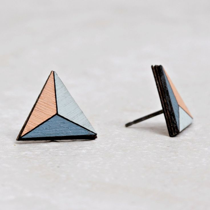 Wonder at the breathtaking moment that the winter sun rises to reach the peak of an expansive mountain. These Evren Earrings are handmade of slate blue, coral, and mint painted birch. Designer Molly M