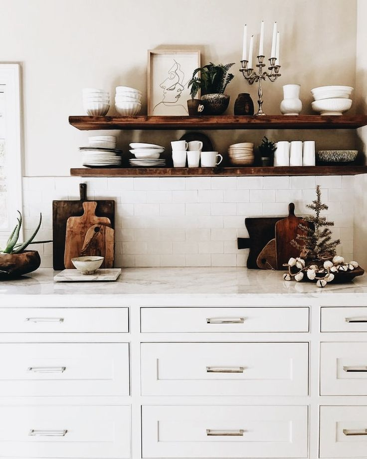 Contrast of the dark floating shelves to the white tile and cabinets is wicked! At Shelfology, we are all about customizing each order to fit your rad shelf needs. Visit our website or call us to start your awesome shelf project!