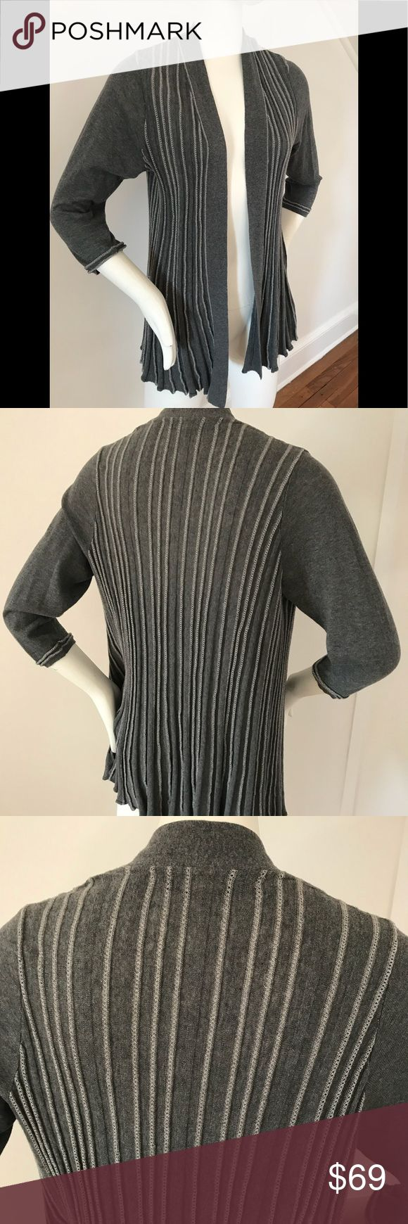Anthropologie Knitted And Knotted Silver cardigan Anthropologie label knitted and knotted ribbed open front cardigan with silver pointelle stitch adds a touch of holiday sparkle to the mix. New without tags and never worn. Size large Anthropologie Sweaters Cardigans