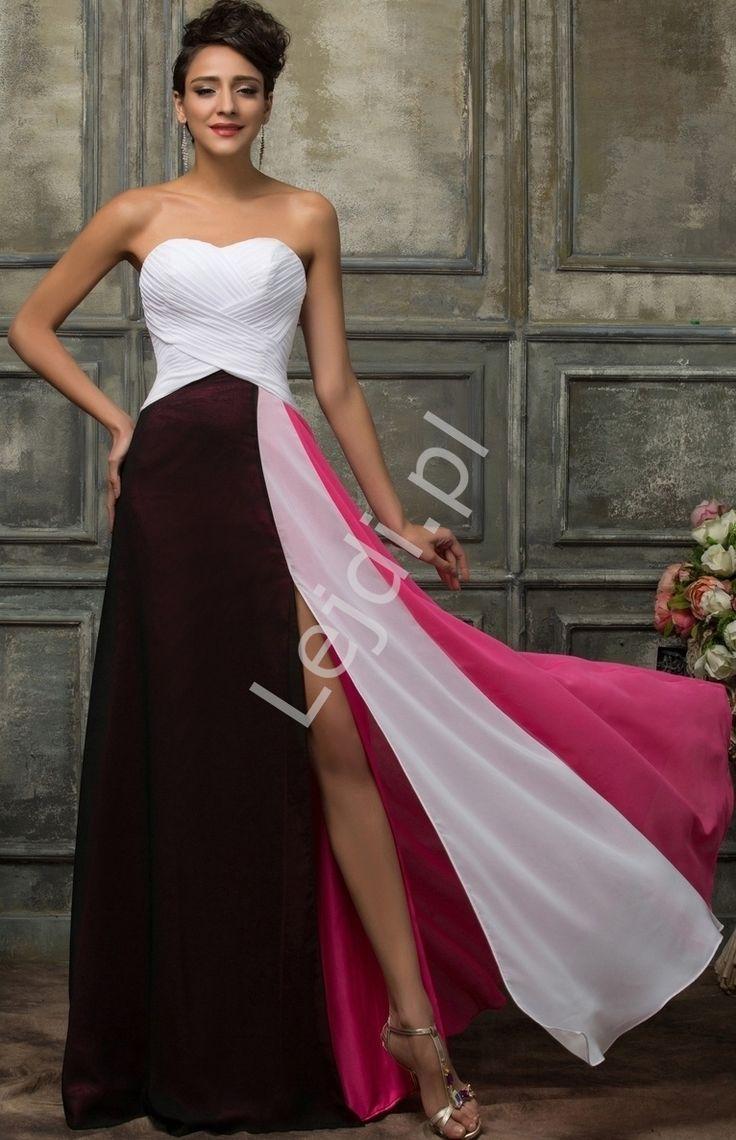 Szyfonowa długa suknia wieczorowa. Góra w kolorze białym, dół czarno różowy. Sukienka z szyfonu z dekoltem w serduszko, na gorsecie pięknie plisowana. Dół sukni luźno puszczony w kolorze czarnym i różowym. Sukienka z rozcięciem na spódnicy. Suknia zapinana na zamek. Krój wyszczuplający poprzez pionowo szyte pasy. Idealna na wesele, studniówkę, dla druhen.