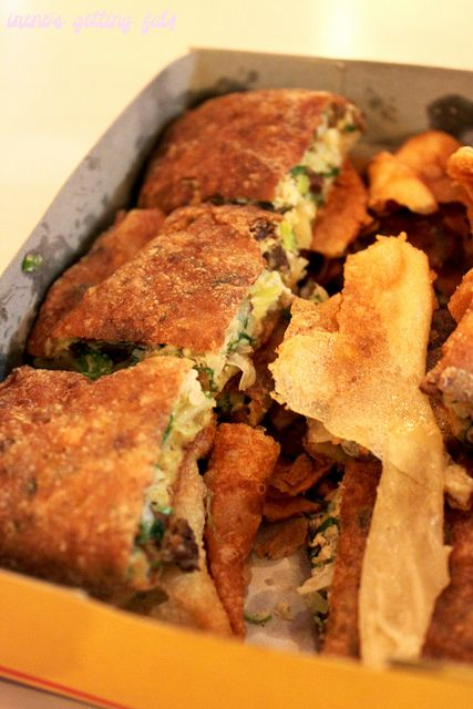 Martabak Telor also known as mutabbaq in arabic or murtabak is a pan fried bread which the ingredients can be vary. usually includes minced mutton along with egg and onion.