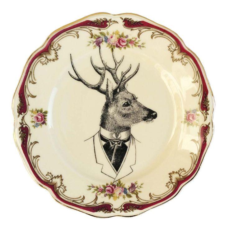 Decoratief bord met gouden gewelfde, elegante bloemenrand en een afbeelding van de charmante Mister Reindeer.