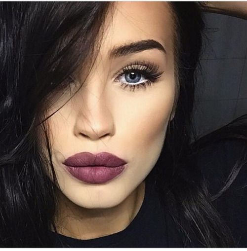 berry plum lips, smoky lids and bold lashes.