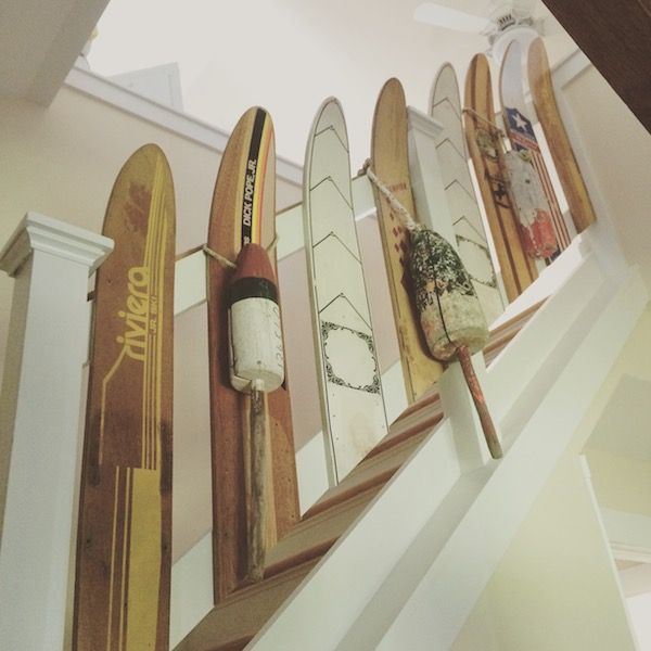 cottage beach decor - repurpose vintage wooden skis.  so many great ideas here.  chairs, shelves, door handles.  you've got to check it out.  #coastaldecor #beach #cottage