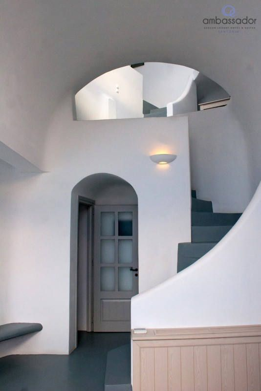 Refined, all-white aesthetics…a classic choice for Cycladic dreams! More at ambassadorhotelsantorini.com
