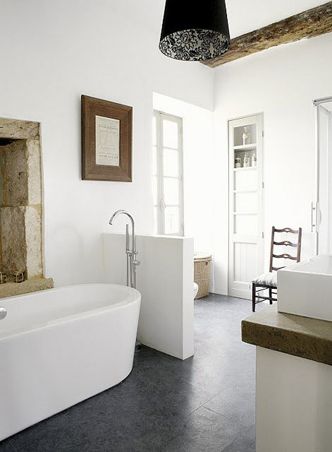 Country home - Dordogne, France. Love half walls in bathrooms.