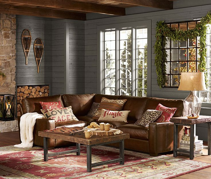 brown wood ceiling grey wall pottery barn living rooms with l shape brown leather sofa cream pillows on pink white rug area brown wood top black iron legs