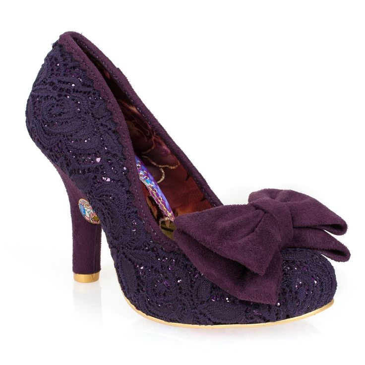 Everyone's favourite Mal E Bow returns this season complete with purple glitter fabric and elegant lace overlay. A pretty faux suede bow on the toe provides a stylish finish on this iconic style.