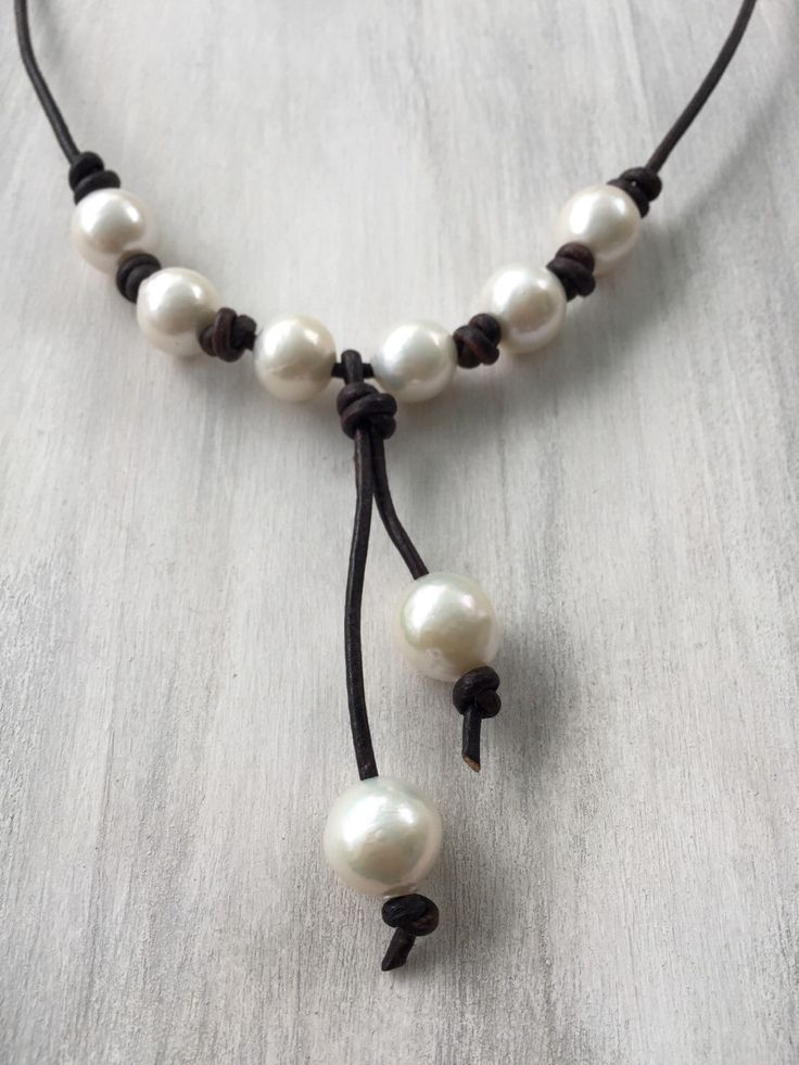 Leather and pearls necklace, pearls on leather, freshwater pearl necklace,pearl jewelry A personal favorite from my Etsy shop https://www.etsy.com/listing/286250177/leather-and-pearl-tassel-necklace-pearls