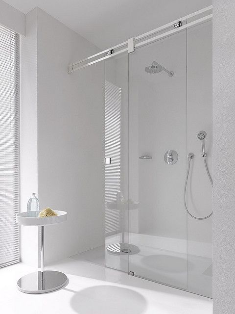 I love barn doors inside, but a glass barn-door shower...thats sweet!