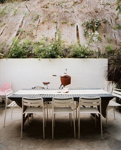 October 2012 Issue Photo   An Outdoor Dining Table Surrounded By White  Chairs