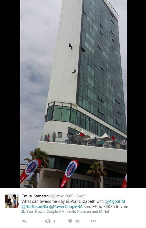 "The couples were 'treated' to another daring feat as Radio Algoa had them ""cleaning"" the windows of the Radisson Blu Hotel, as they abseiled all the way down. Here Emile tweets his excitement of the adventure."