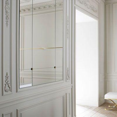 Balmain store in Paris by Joseph Dirand, classical mirrored white walls _